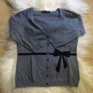 Limited cardigan with bow